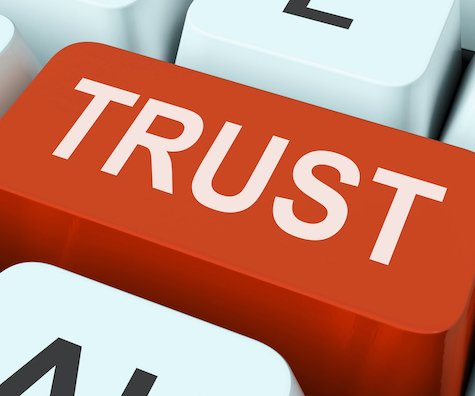keyboard key that says the word 'trust'; building a culture of trustis essential during remote work
