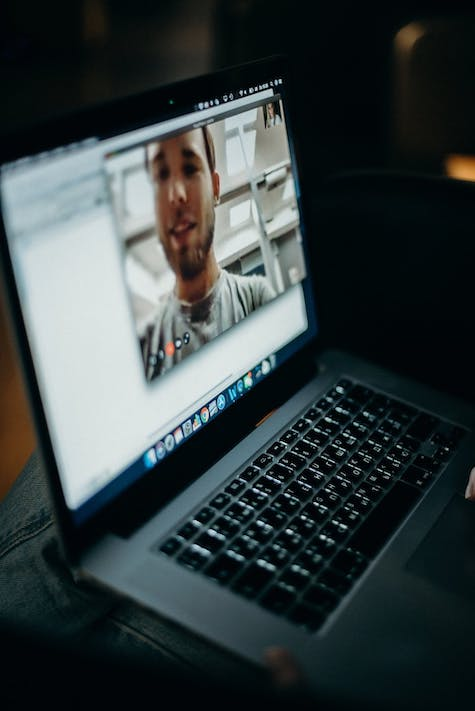 computer on a video call; use these tips for coaching a remote workforce