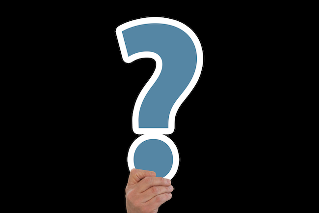 hand holding question mark; which communication style is best in a leader?