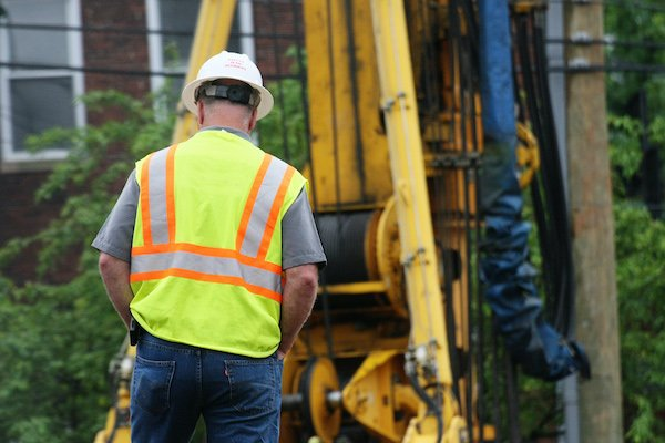worker is walking on construction site