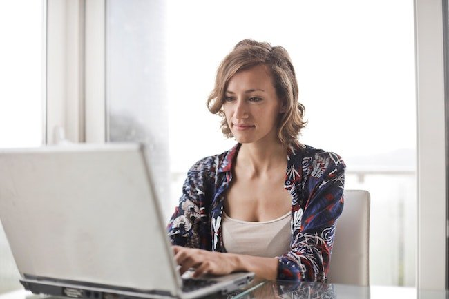 Content women working from home on a laptop