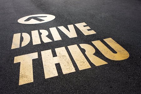 drive thru sign on road COVID-19 and South Korea