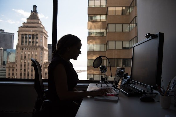 woman working from her office, considering the ethics of flex work