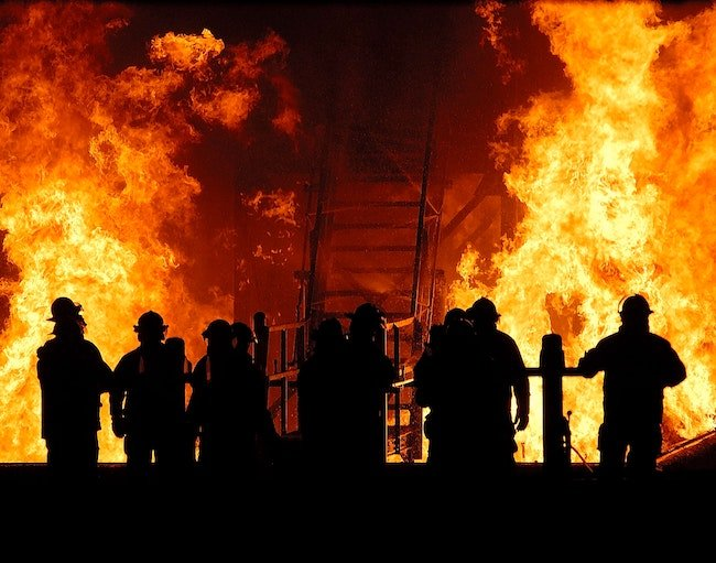 firemen fighting a fire; having an emergency preparedness plan is essential to keep your organization safe