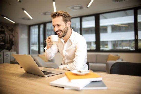 employee enjoying the benefits of flex work while drinking coffee