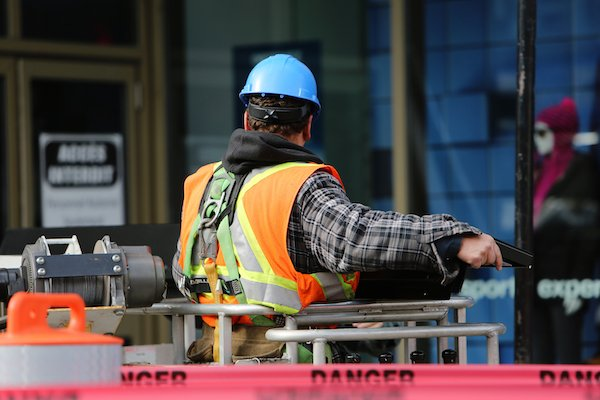 man on construction site increasing employee safety commitment