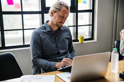 man working on laptop in a company culture that supports flex work