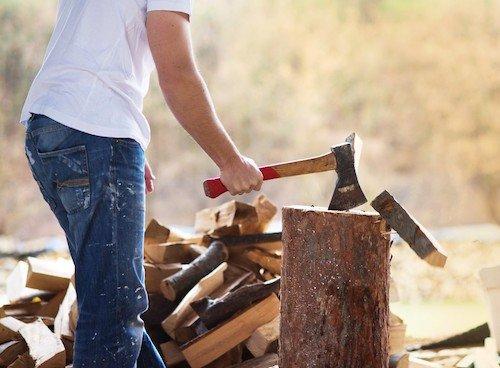 lumberjack chopping wood; in this post, a man nicknamed the lumberjack fakes injuries to abuse injury benefits