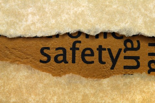 The word safety written on brown paper; safety care should be prioritized over compliance