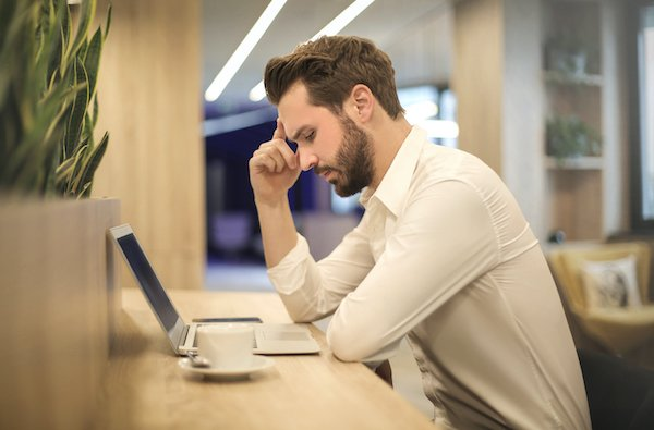 men looking computer with stress and worries