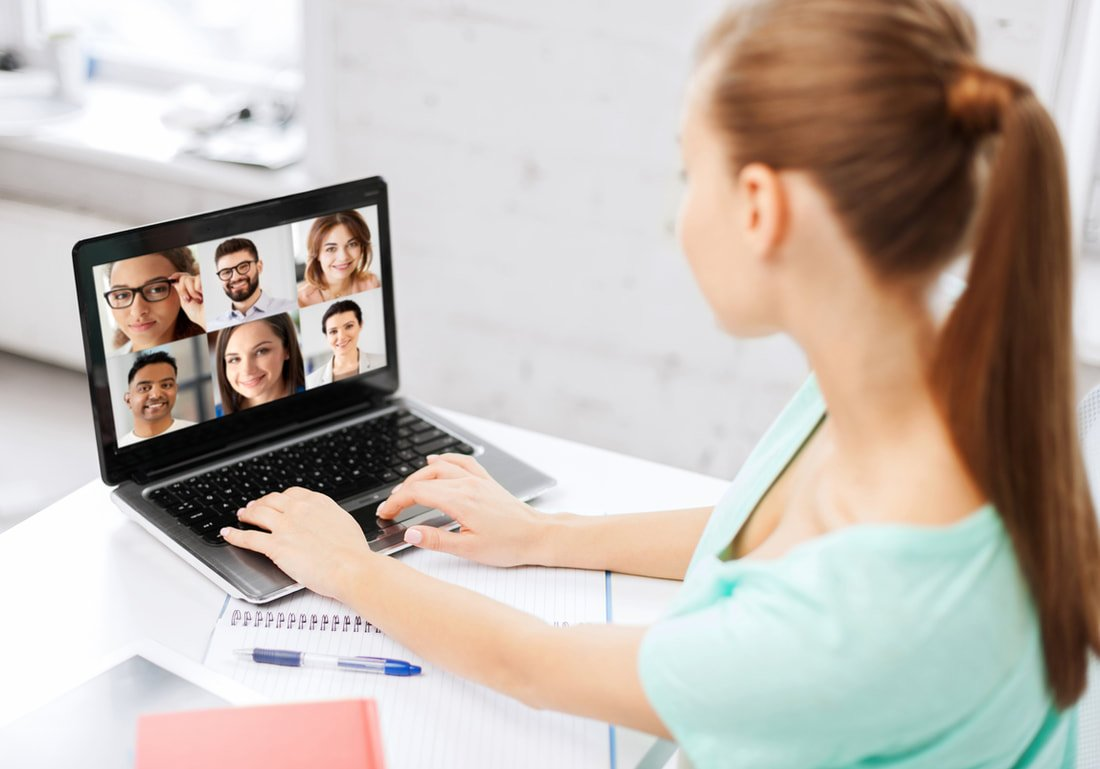 working virtually at home with video conference call