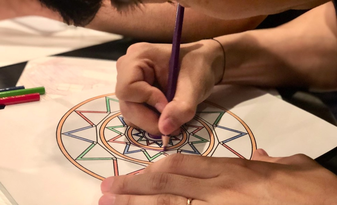 A men is drawing Mandala Art Theraphy