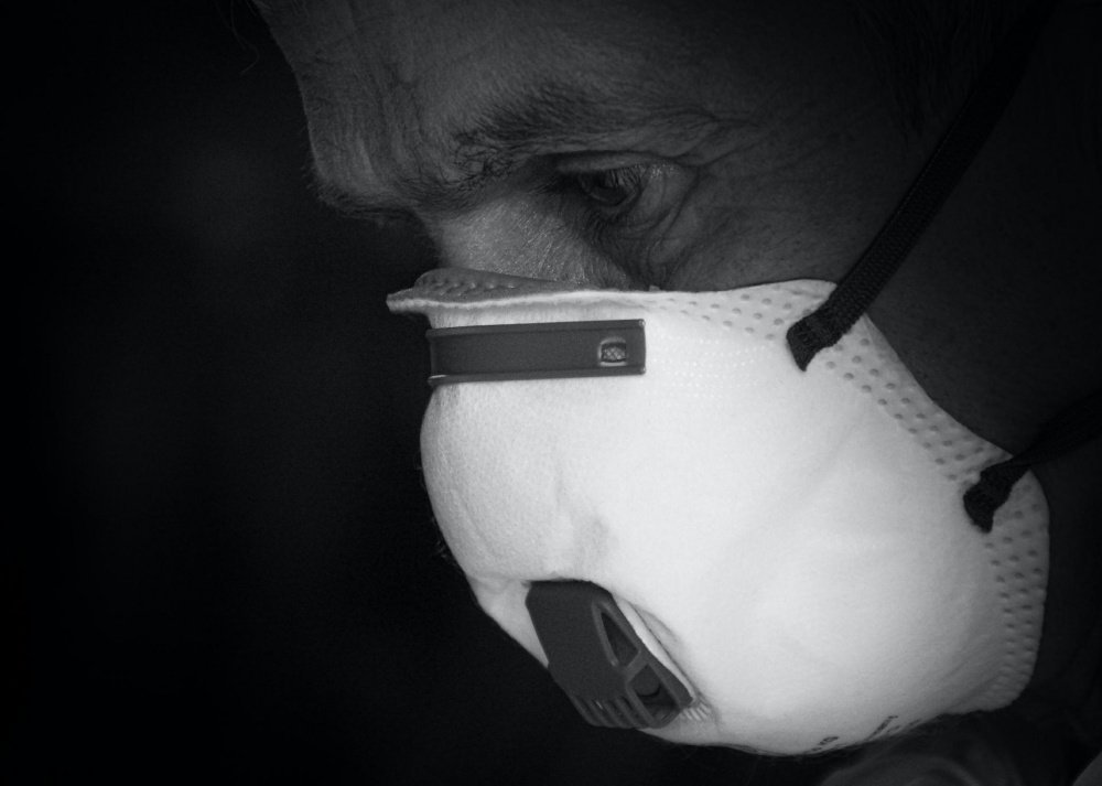 Man with face mask black and white image