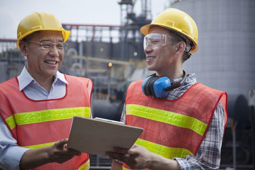 two men in orange vests taking safety leadership competencies test